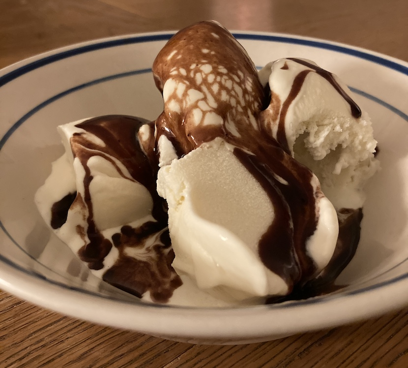 Alice Neel's hot-fudge sauce ornamenting vanilla ice cream